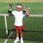 Ellie with her trophies from the county championships 2013
